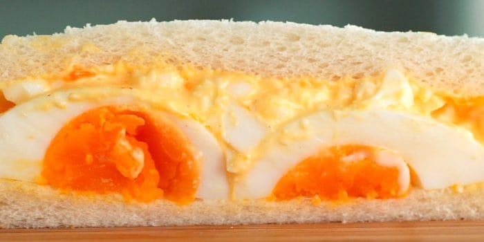 Japanese style egg sandwich with halved medium boiled eggs and egg salad.