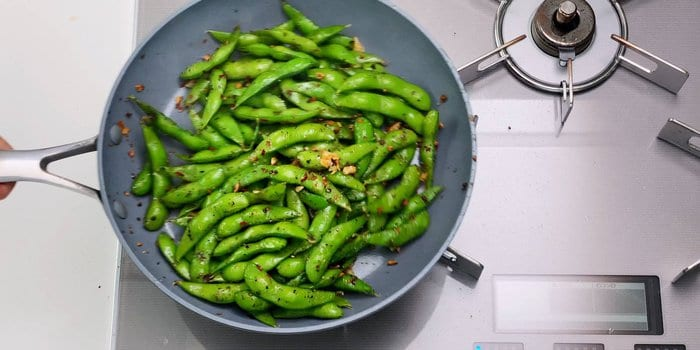 Edamame stir-fried with garlic, chili flakes and black pepper.