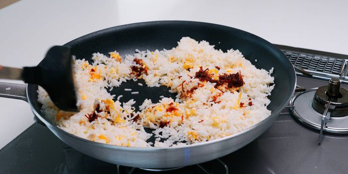 Egg fried rice in a frying pan.