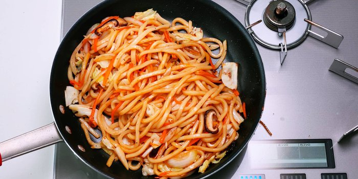 Yaki Udon (Japanese stir-fried noodles) in a frying pan.