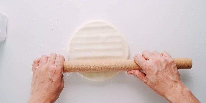 Pressing out udon dough.