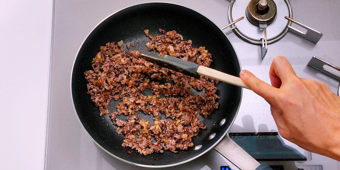 Saute ground beef with onions.