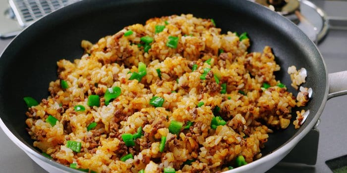 Curry fried rice with green peppers, beef, and caramelized onions.