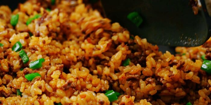 Japanese curry fried rice in a frying pan.