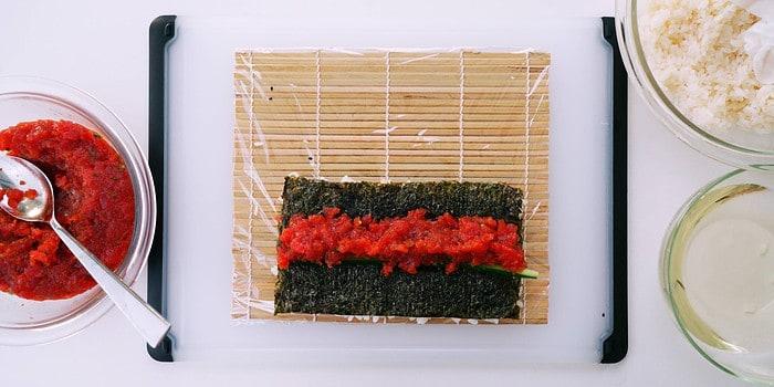 Spicy tuna mixture and cucumber on nori.