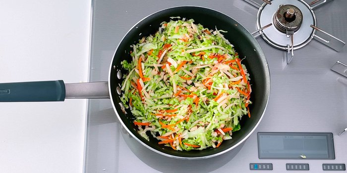 Shredded cabbage, carrots, mushrooms and bamboo for making Japanese-style spring rolls.