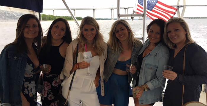 Group of women smiling, enjoying their party. Party boat rental Charleston, SC
