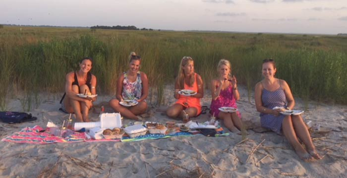 Group of women enjoying a picnic on the beach. Boat charter Charleston SC