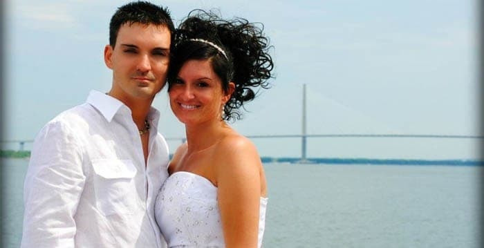 Bride and groom portrait with bridge in the background. Wedding dinner cruise Charleston SC