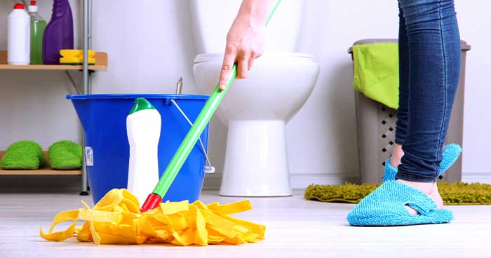 The final step of deep cleaning the bathroom is mopping.