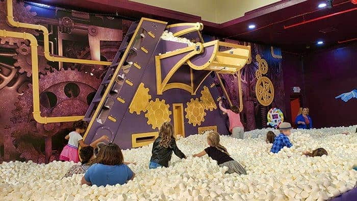 People playing in the giant Candytopia marshmallow pit