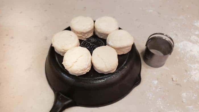 biscuit dough on the back of a cast-iron pan