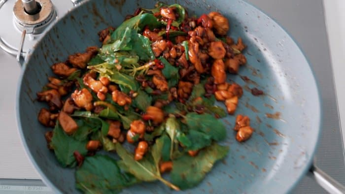 Tossing Holy Basil with Chicken for Pad Kraprow Gai