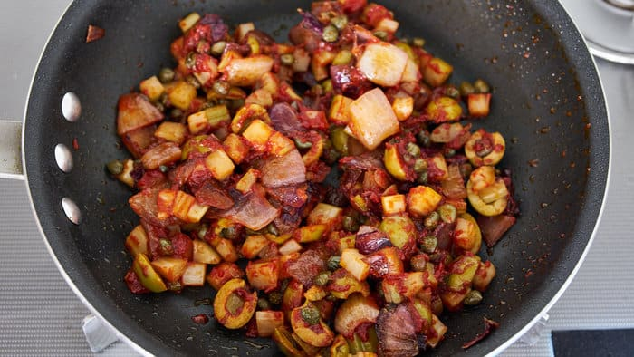 Caramelizing the tomato paste brings out the sweetness of the tomatoes in this Caponata.