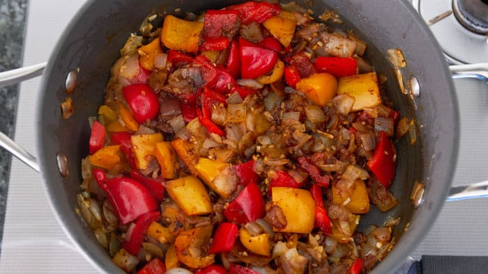 Chili powder is added and sauteed to bring out it's fragrance.