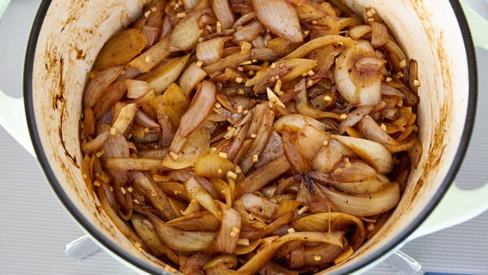 Caramelized onions and garlic in dutch oven for hayashi rice.