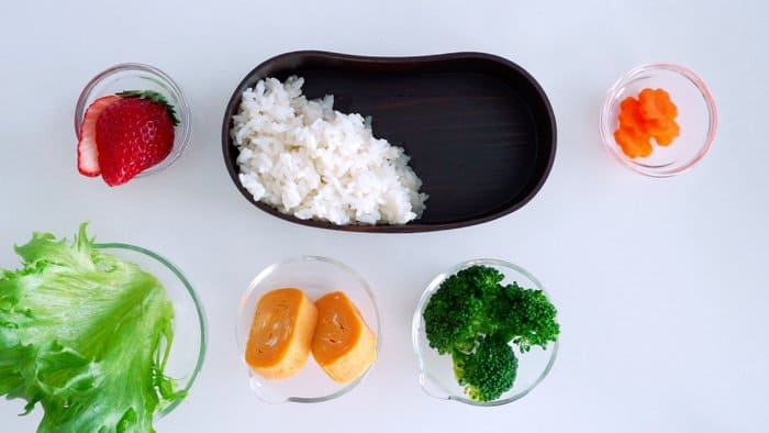 Packing a bento starts with rice.