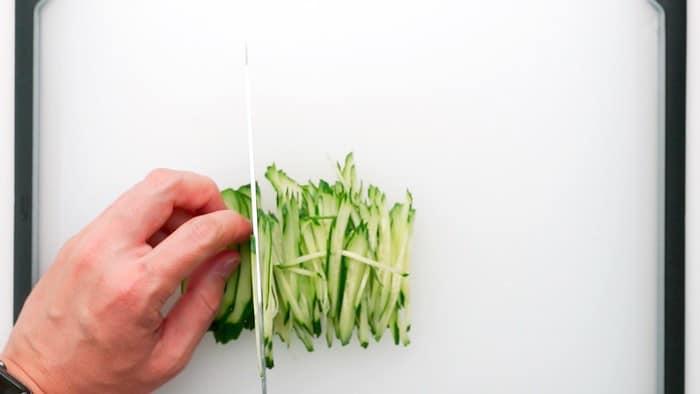 Cutting the cucumber into matchsticks for Hiyashi Chuka.