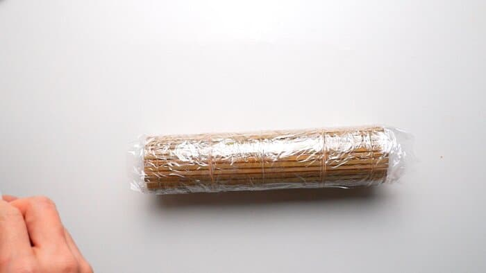Datemaki rolled in bamboo matt wrapped in plastic.