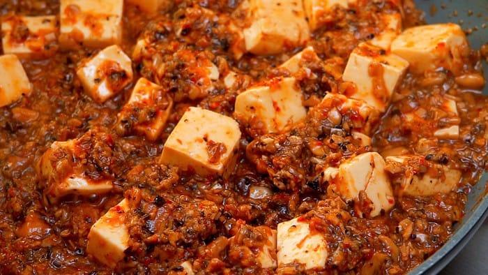 Vegan Mapo Tofu simmer in a frying pan.