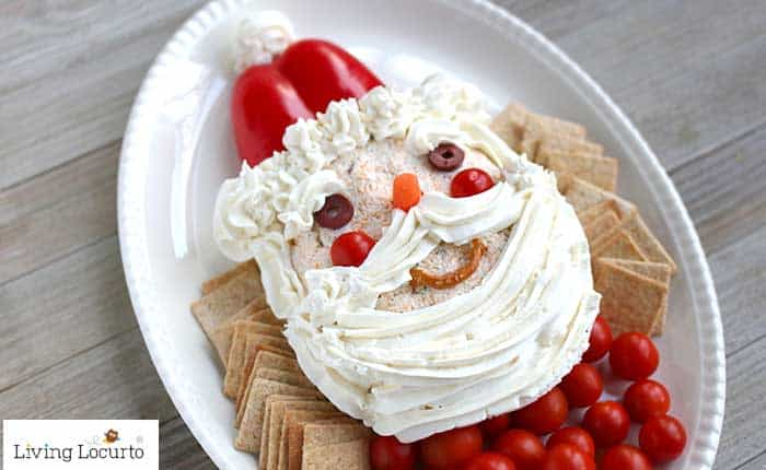 Santa Cheese Ball Christmas Party appetizer made with a ranch and cheddar cheese ball recipe. LivingLocurto.com