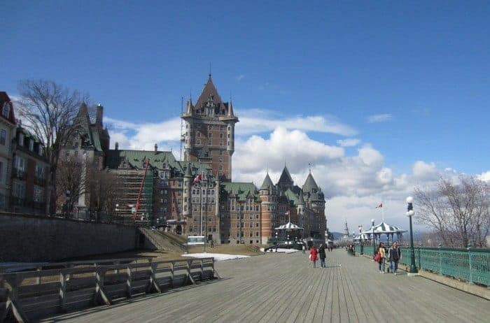The boardwalk in quebec's upper old town with the chateau frontenac in the background.