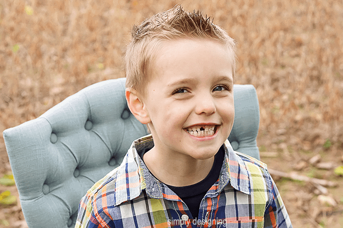 family Photo of Boy sitting in a chair in a field Close Up