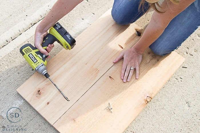 "Making shelves for Printer Table using Ryobi drill to screw 2 10"" wide boards together using pocket holes"