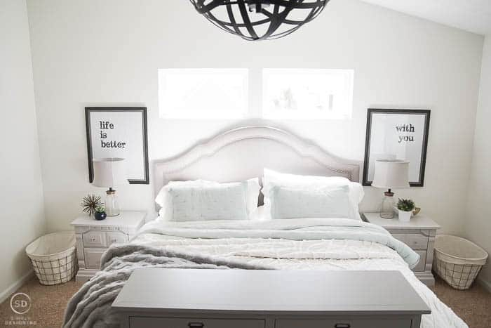 Master Bedroom Makeover with painted grey bedside tables, typography prints and cozy bedding