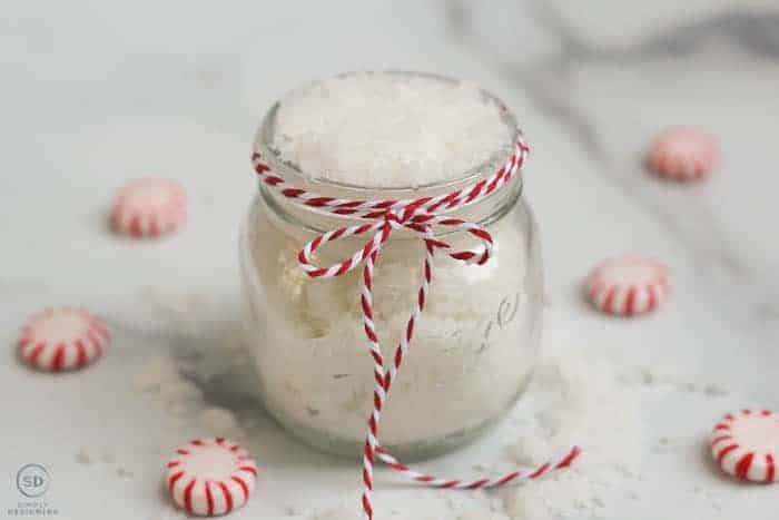 Peppermint Sugar Scrub in a glass jar with red and white twine around the jar