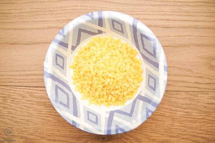 beeswax pellets in a bowl
