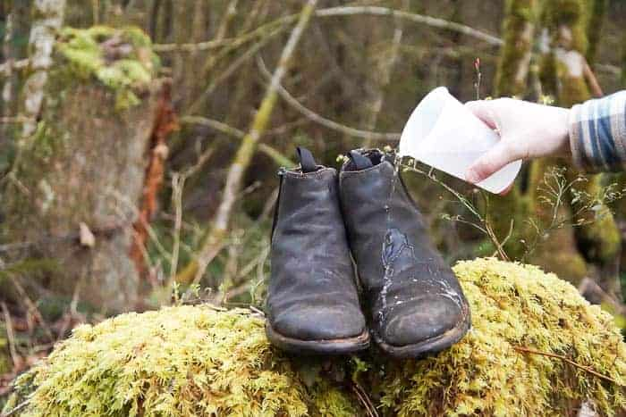 pouring water over newly waterproofed leather boots