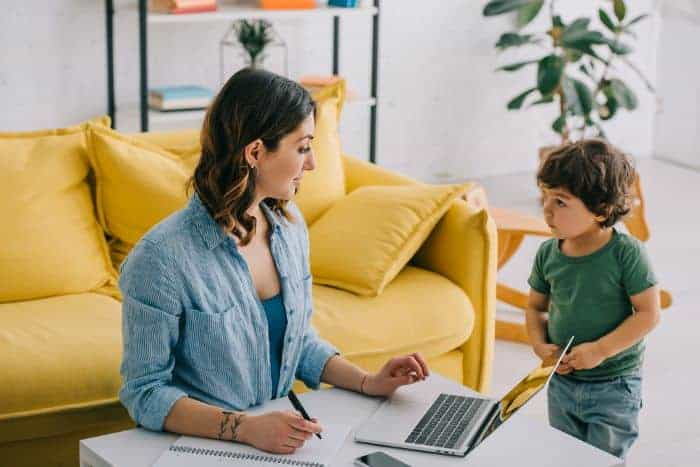 mom with young child working from home
