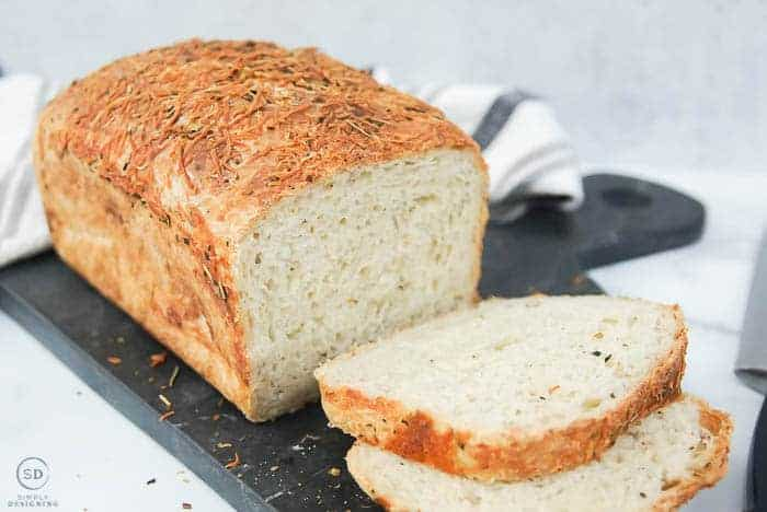 Parmesan Rosemary Bread recipe sliced and on black marble board