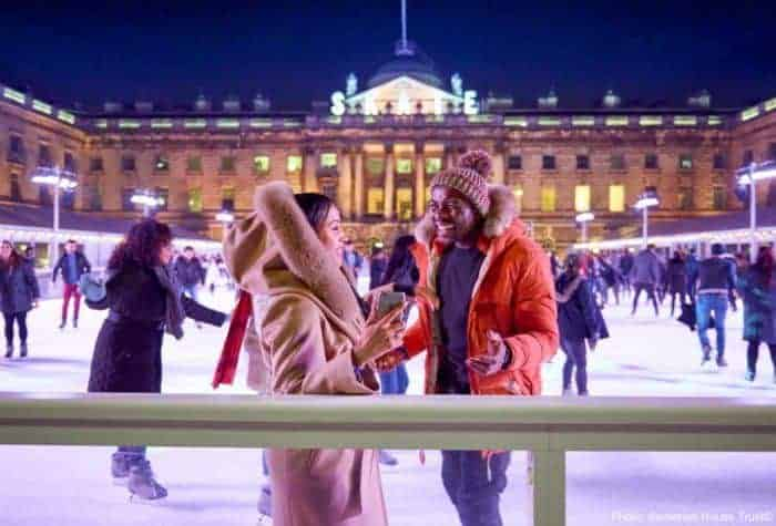 Ice skating in front of stately somerset house