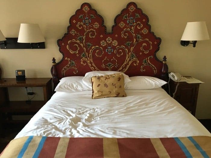 Handpainted headboard are one of la fonda's signature details.