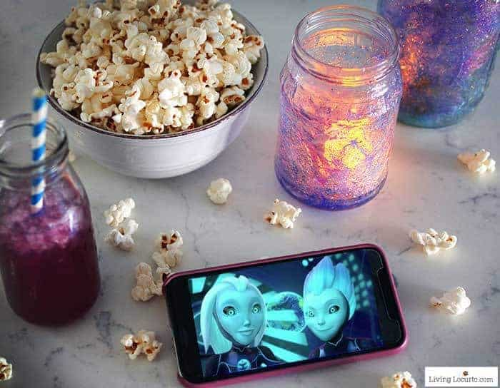 How to make Glow in the Dark Galaxy Jars. An easy DIY craft tutorial and party decor idea for kids. Inspired by 3Below, a kid Netflix series.