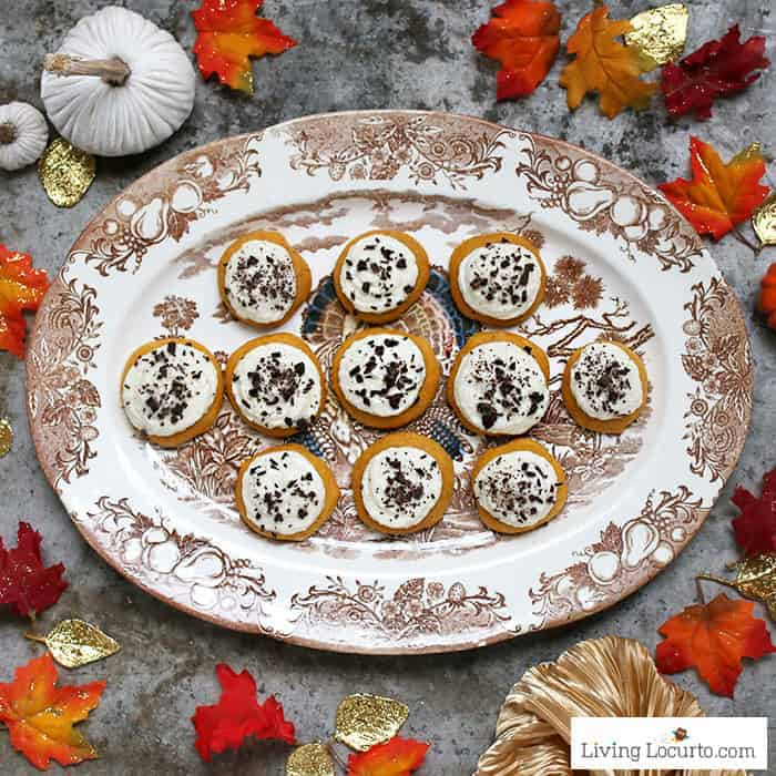 Pumpkin cookies! Easy cake mix cookies recipe with buttercream frosting and dark chocolate. Perfect pumpkin spice dessert for fall.