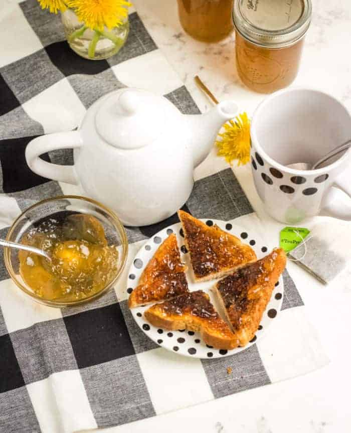 Table set up for breakfast with toast and tea.