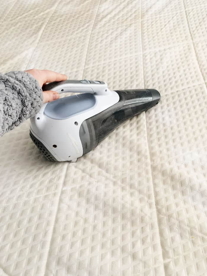 Vacuum the baking soda off the mattress.