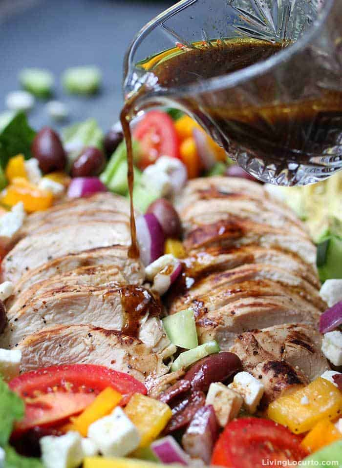 Baked Chicken Greek Salad with homemade dressing and fresh vegetables. Juicy baked chicken and fresh avocado slices loaded onto a Greek salad is a low carb recipe.