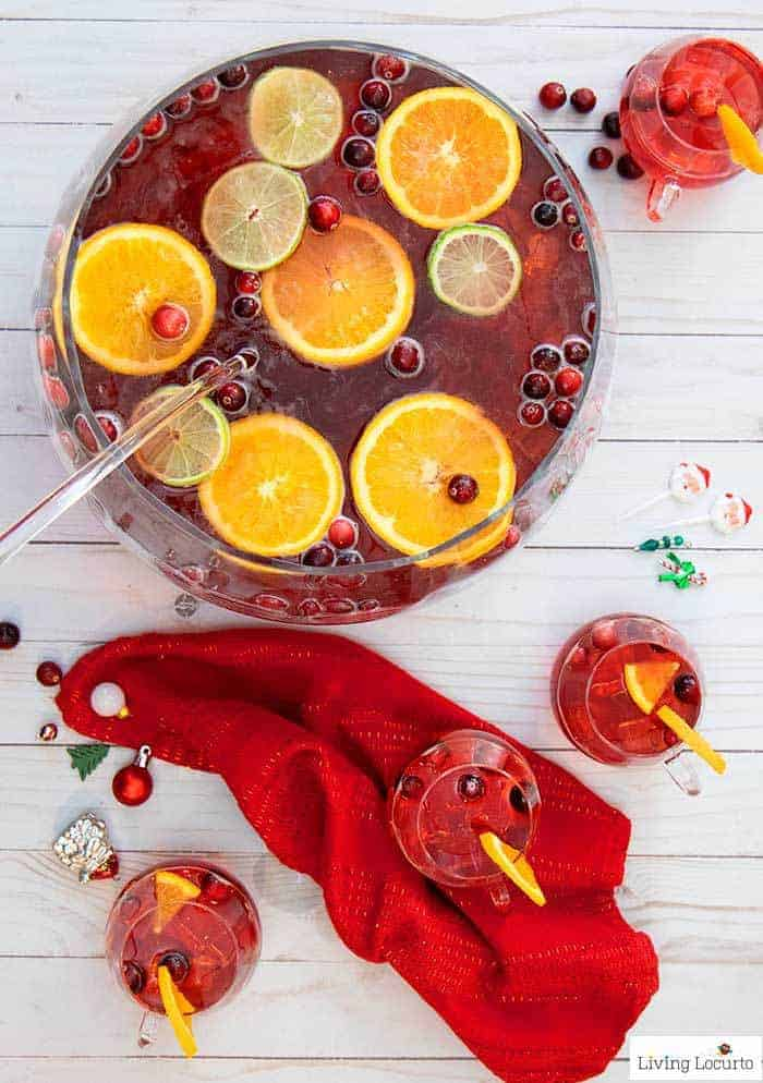 Easy Holiday Punch Recipe! Delicious Christmas drink for a party with limes, oranges and cranberry.