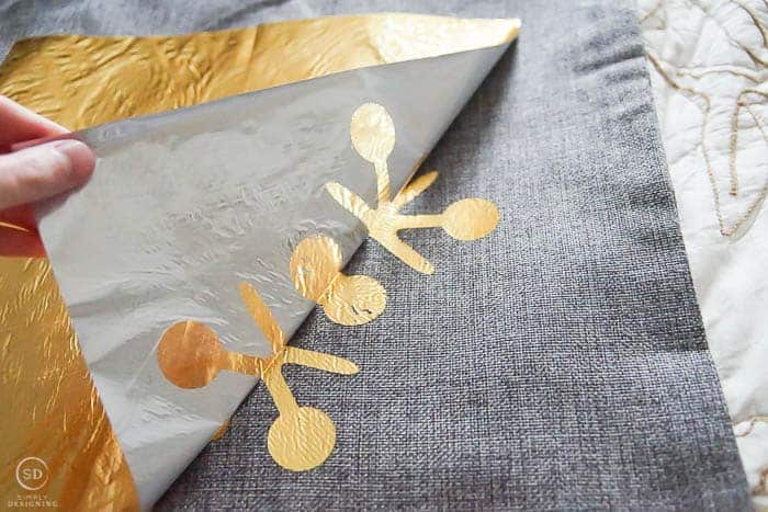 remove excess gold foil from fabric