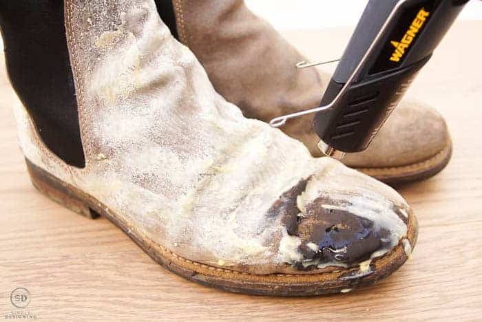 use a heat gun to waterproof leather boots by melting beeswax into boots
