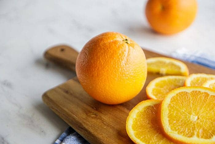 Whole oranges ready to peel for a smoothie.