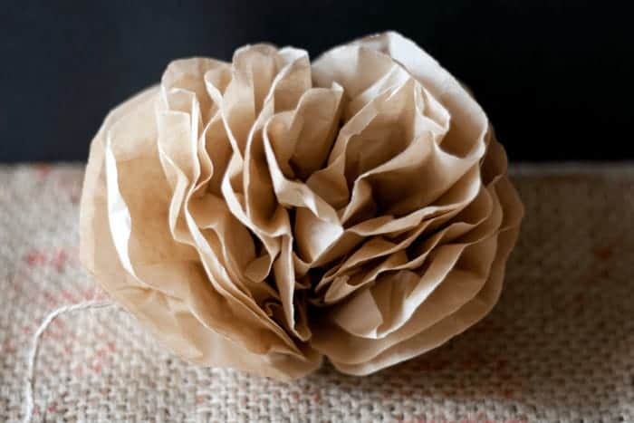 Cheap creative crafting with paper and twine - beautiful pom pom flowers made from coffee filters