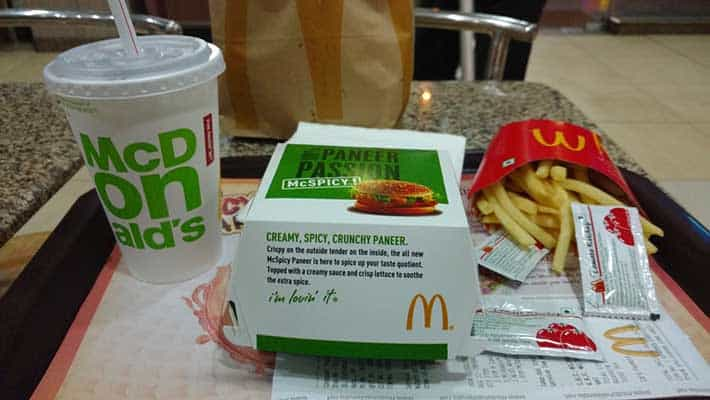McDonalds meal with paper cup and plastic straw