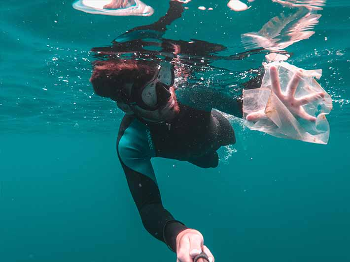 Plastic bag in the ocean with diver