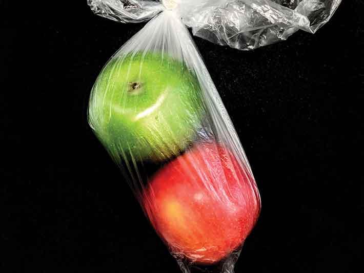 Plastic bag of apples