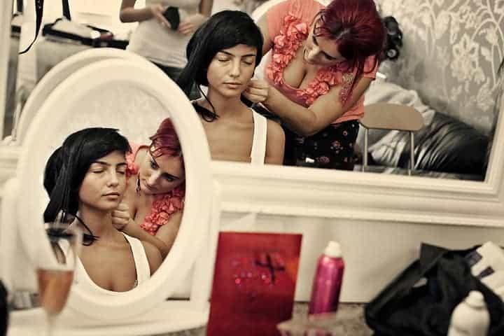 bride having hair done by hairdresser